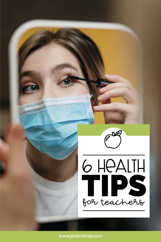 lady looking in a mirror putting on mascara with a mask on health tips for teachers during pandemic